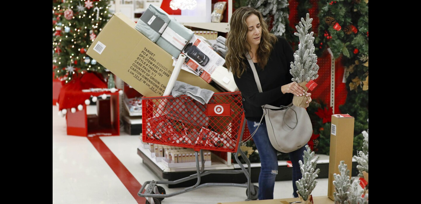 Antonieta Beltran of Tijuana has her cart loaded up while Black Friday shopping at the Target store in Mission Valley.