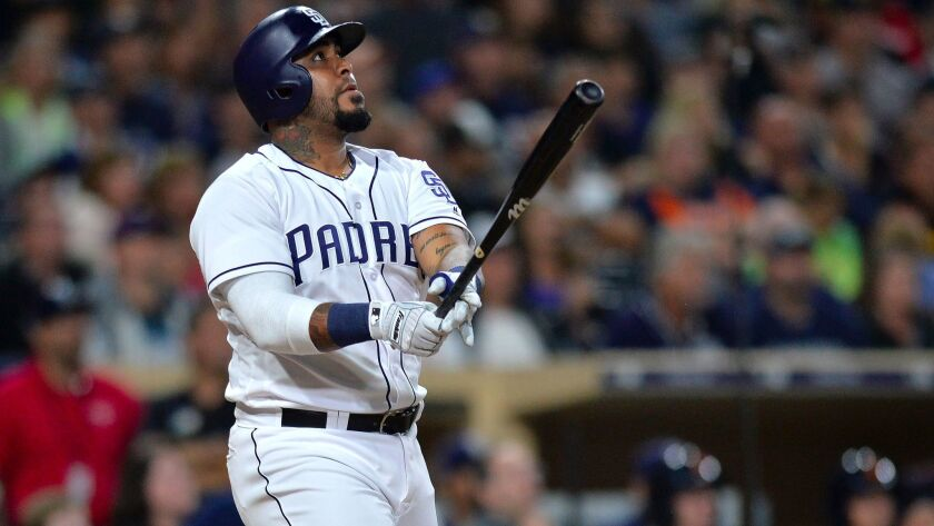 San Diego Padres catcher Hector Sanchez hits a two-run home run during the eighth inning against the Detroit Tigers at Petco Park.
