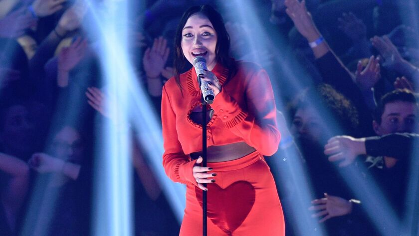 Noah Cyrus performs during Sunday's iHeartRadio Music Awards.