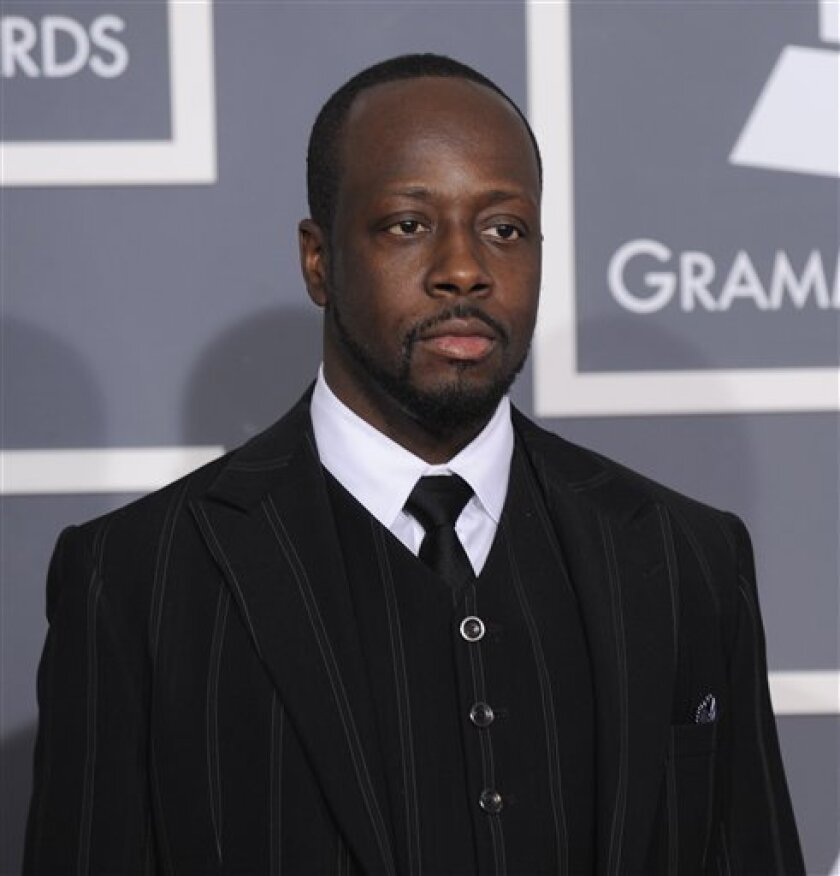 Wyclef Jean arrives at the Grammy Awards on Sunday, Jan. 31, 2010, in Los Angeles. (AP Photo/Chris Pizzello)