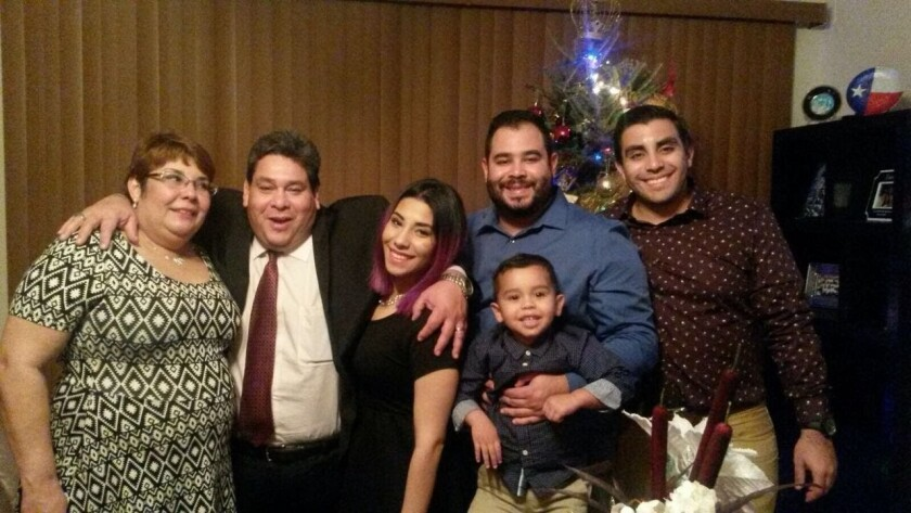 This December 2015 family photo shows Jose Pereira, second left, one of the Houston-based Citgo oil executives convicted and ordered to prison in Venezuela, pictured with his wife Mervis, from left, and children, Sara, John, unidentified grandson and Joao, in Houston, Texas. Jose Pereira, 63, is one of the six American oil executives held for three years in Venezuela who were found guilty of corruption charges by a Venezuelan judge on Thursday, Nov. 26, 2020. (Courtesy of John Pereira via AP)