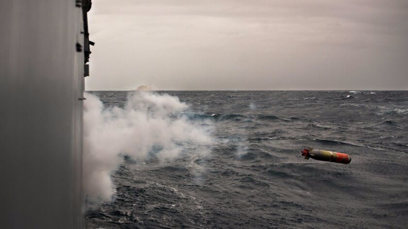 An extorp is launched from the Navy cruiser Bunker Hill during an undersea warfare exercise on May 7