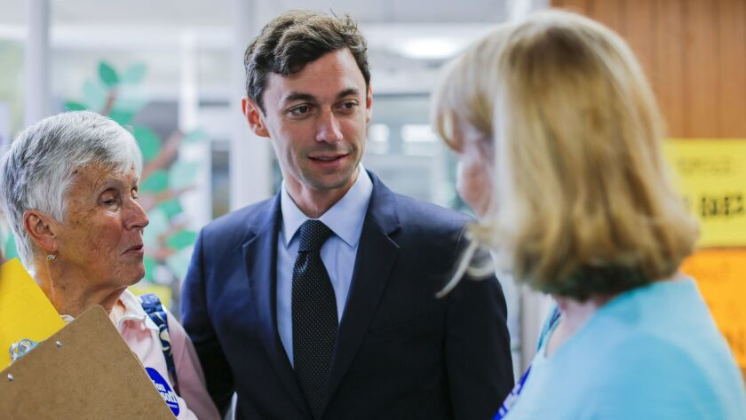 epa05906362 Democratic US House of Representatives candidate Jon Ossoff (C) greets volunteers at a c