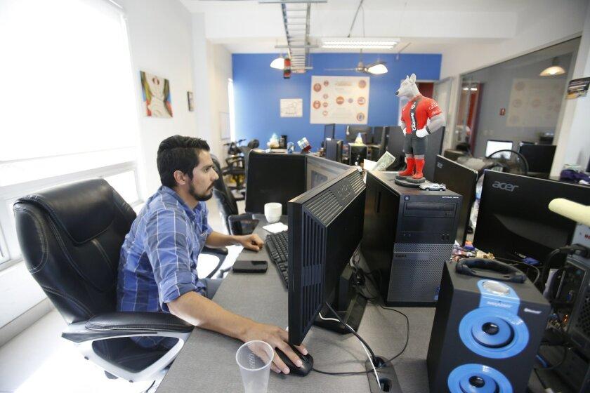 Software programmer José Cornejo works at the tech incubator MIND Hub on a Tijuana accountant's proposal for Contarte.mx, a platform for accounting management. Cornejo is a graduate of the Universidad Tecnologica de Tijuana.