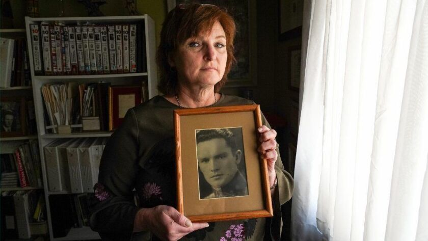 Silvia Foti holds a photograph of her grandfather Jonas Noreika at her home in Chicago on Jan. 11, 2019. Foti was raised to think of her grandfather as a Lithuanian hero. However, she later discovered that he was an accomplice to the Holocaust.