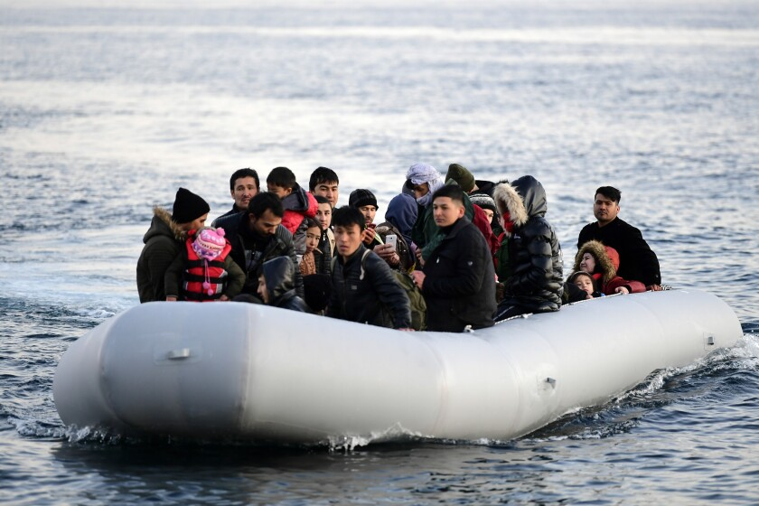 Migrants arrive at the village of Skala Sikaminias, on the Greek island of Lesbos, after crossing on a dinghy the Aegean sea from Turkey on Monday, March 2, 2020. Thousands of migrants and refugees massed at Turkey's western frontier, trying to enter Greece by land and sea after Turkey said its borders were open to those hoping to head to Europe. (AP Photo/Michael Varaklas)