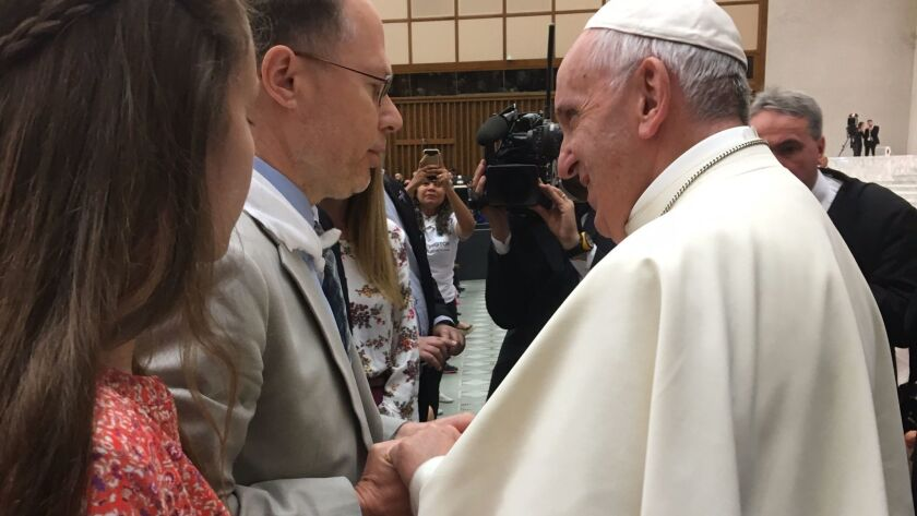 With his daughter, Bianca, looking on, Ken Serbin thanks Pope Francis for his support of the Hunting