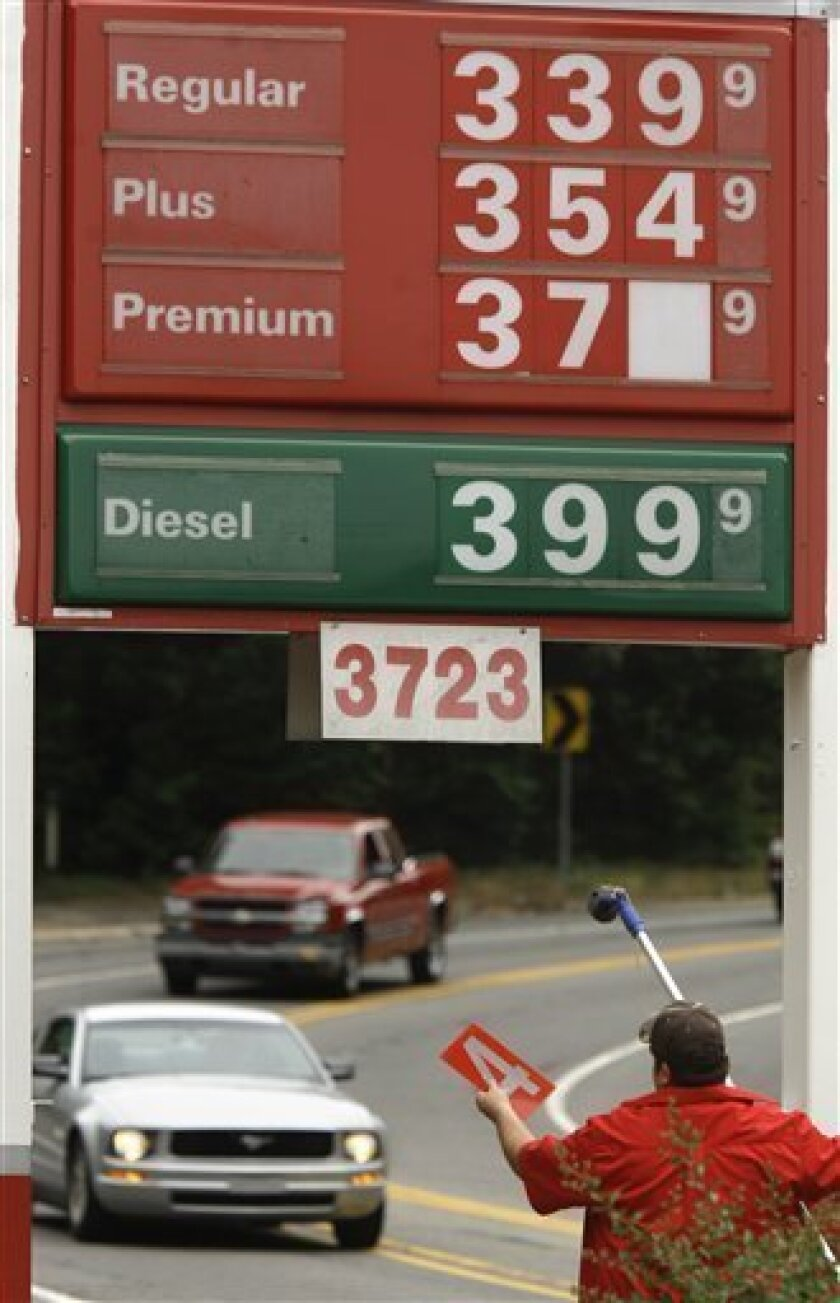 In this June 22, 2011 photo, gas station manager Joseph Sublett changes a sign reflecting lower prices in Little Rock, Ark. Wary of a new surge in gas prices, the Obama administration has decided to release 30 million barrels of oil from the country's emergency reserve as part of a broader international response to lost oil supplies caused by turmoil in the Middle East and North Africa, particularly Libya.(AP Photo/Danny Johnston)