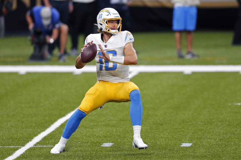 Chargers quarterback Justin Herbert looks to pass against the New Orleans Saints on Oct. 12, 2020.