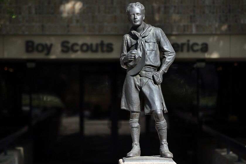 A statue of a Scout stands outside the Boy Scouts of America offices in Irving, Texas.
