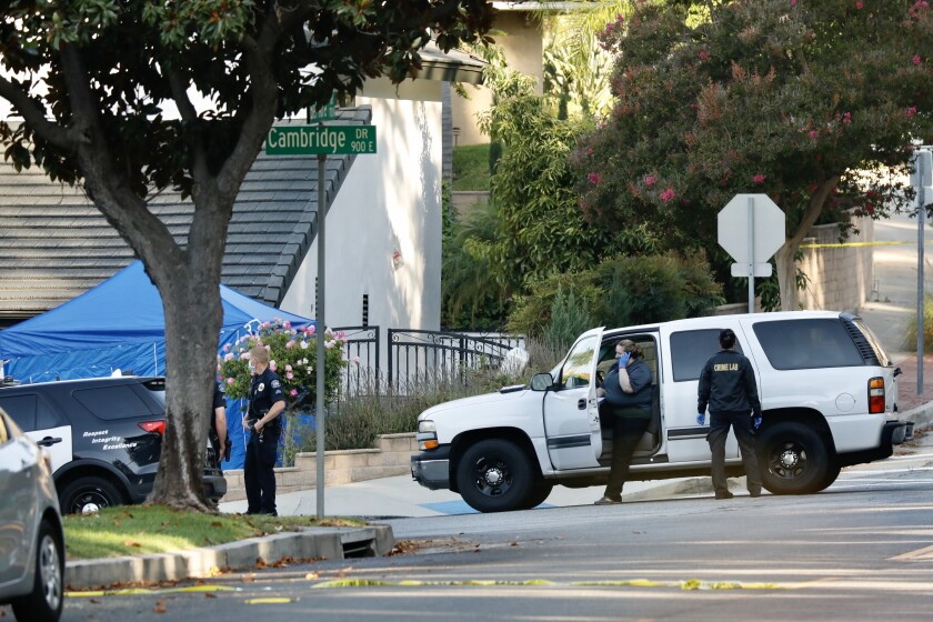 Two men were killed and a woman was injured in a shooting at a home in Burbank.