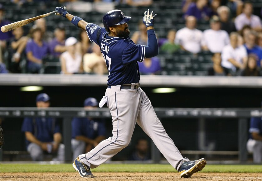San Diego Padres' Matt Kemp watches his RBI triple off Colorado Rockies relief pitcher Justin Miller during the ninth inning of a baseball game Friday, Aug. 14, 2015, in Denver. With the triple, Kemp hit for the cycle as San Diego won 9-5. (AP Photo/David Zalubowski)