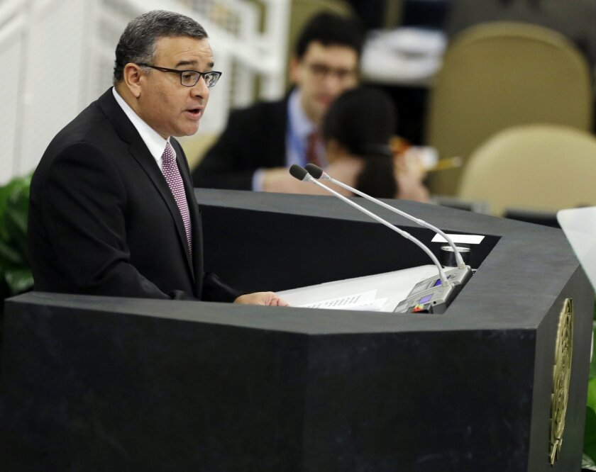FILE - In this Sept. 25, 2013 file photo, El Salvador's President Mauricio Funes addresses the United Nations General Assembly at U.N. headquarters. On Wednesday, Feb. 10, 2016, El Salvador's Supreme Court ordered a civil court to start legal proceedings against the former leader for alleged embezz