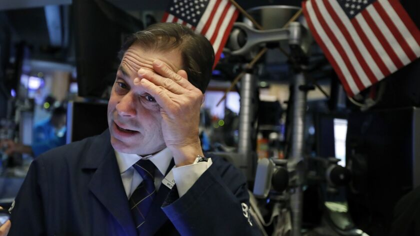 Trader Dudley Devine works on the floor of the New York Stock Exchange.