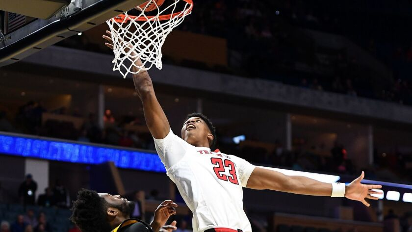 Texas Tech's Jarrett Culver scores over Northern Kentucky's Trevon Faulkner during a first-round game NCAA tournament game March 22 in Tulsa.
