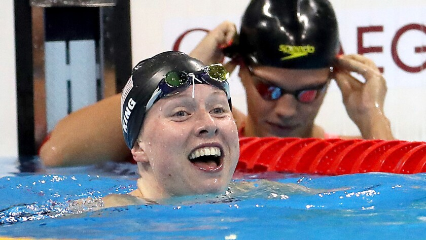 American swimmer Lilly King is all smiles after defeating rival Yulia Efimova of Russia for gold in the women's 100-meter breaststroke on Monday.