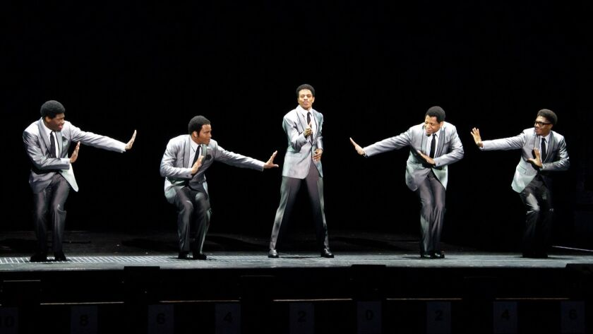 """Jawan M. Jackson, from left, James Harkness, Jeremy Pope, Derrick Baskin and Ephraim Sykes in """"Ain't Too Proud"""" at the Ahmanson Theatre."""