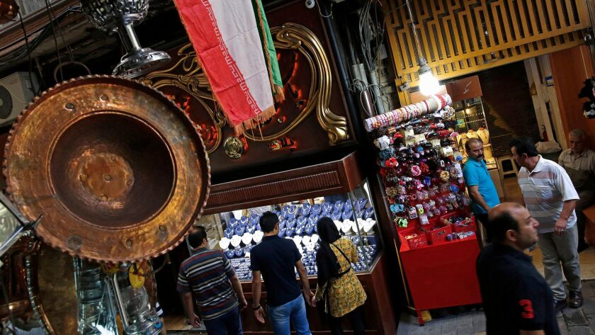 TEHRAN, IRAN--At Tehran Grand Bazaar, a couple looks a jewelry in the gold market. (Carolyn Cole/Los