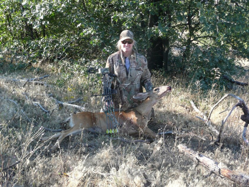 Jennifer Larson Paulson never took a shot with her bow and arrow last year, but her first one this year downed a husky doe, her first deer ever.