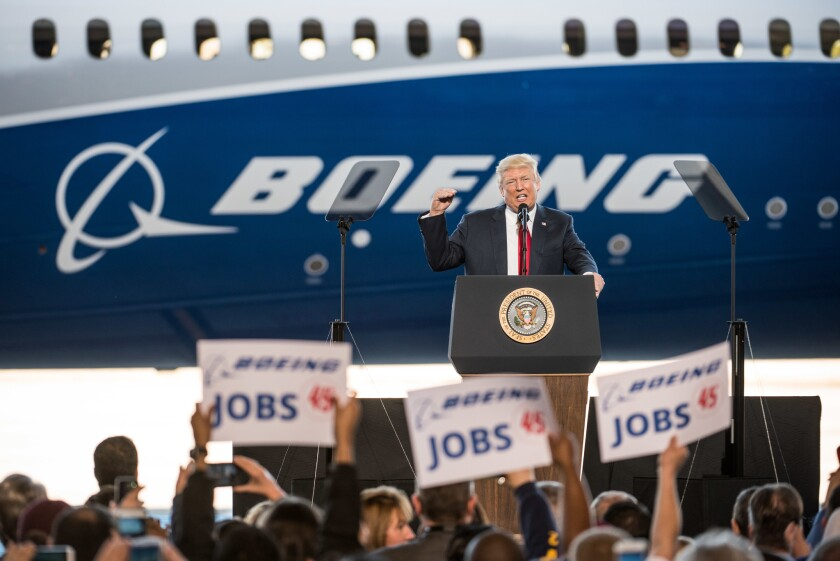President Donald Trump addresses a crowd during the debut event for the Dreamliner 787-10 at Boeing's South Carolina facilities on February 17, 2017 in North Charleston, S.C. The airplane manufacturer announced it will layoff workers at the plant.