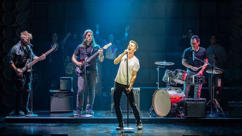 "F. Michael Haynie as Glenn, Lucas Papaelias as JJ, Matt Doyle as Bobby, and Zachary Noah Piser as Eli in the world premiere of ""The Heart of Rock & Roll"" at the Old Globe."