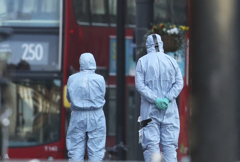 Police forensic officers at the scene of a stabbing attack in the Streatham area of south London.
