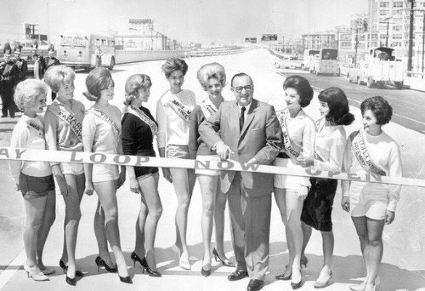 With the help of young women representing other roadways in the region, then-Gov. Pat Brown cut the ribbon to open the Santa Monica Freeway to traffic in 1962.