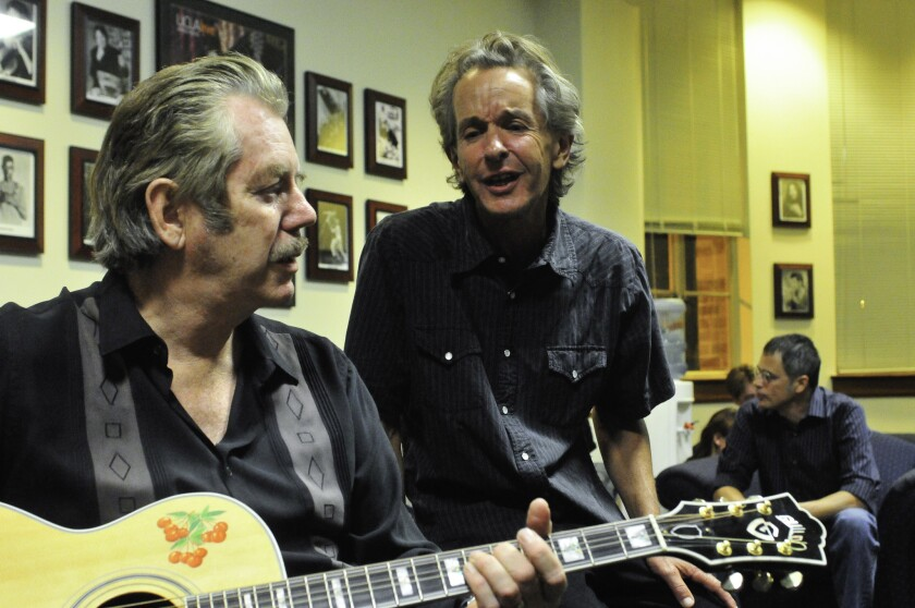 John Chelew, right, backstage with Dan Hicks at McCabe's 50th anniversary celebration at UCLA in 2008.