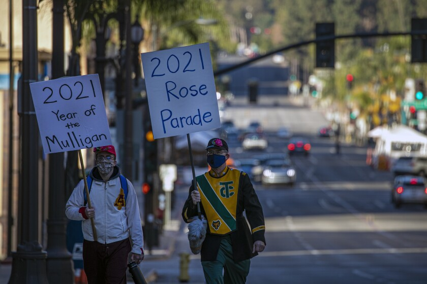 Curtis McKendrick, 26, left, and  his father Robert McKendrick, 60, make their own 2021 Rose Parade march