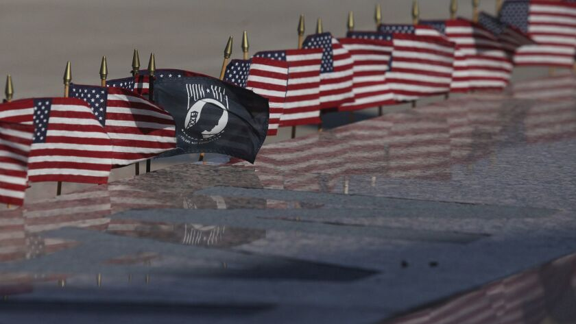 A National League of Families POW/MIA flag is placed around Permian Basin's Vietnam Memorial with Am