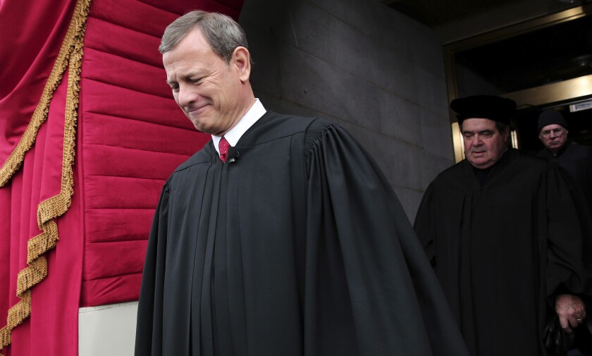 """Efforts are underway to attempt to overturn the controversial Supreme Court """"Citizen's United"""" decision. Above, Chief Justice John Roberts, followed by Justice Antonin Scalia in January of 2013."""