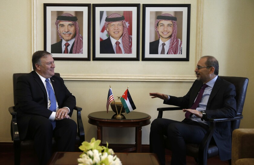 U.S. Secretary of State Mike Pompeo, left, meets with Jordanian Foreign Minister Ayman Safadi in Amman, Jordan, on April 30, 2018.