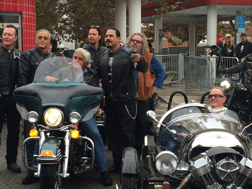 """Celebrity motorycle enthusiasts -- from left, actor Robert Patrick, Love Ride founder Oliver Shokouh, comedian Jay Leno, the cast of """"Sons of Anarchy"""" and """"Easy Rider"""" actor Peter Fonda -- gather for the start of the 32nd and final running of the annual charity fundraiser."""