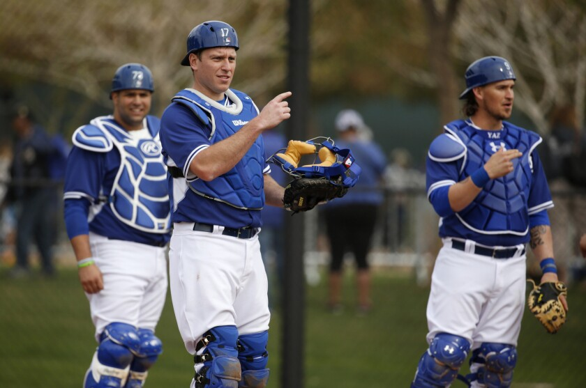 A.J. Ellis, center, goes through drills with Shawn Zarraga, left, and Yasmani Grandal, right, during the Dodgers' pitchers and catchers workout.