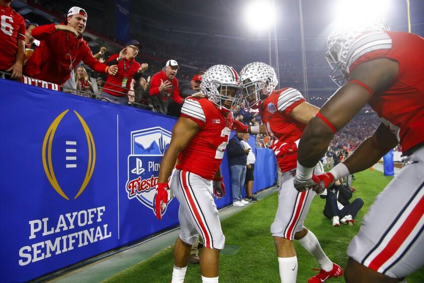Ohio State running back J.K. Dobbins celebrates his touchdown with wide receiver Austin Mack on Dec. 28, 2019.