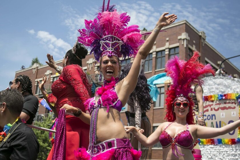 Thousands gather on the North Side of Chicago for the 47th annual Chicago Pride Parade on Sunday, June 26, 2016. (Ashlee Rezin/Chicago Sun-Times via AP) MANDATORY CREDIT