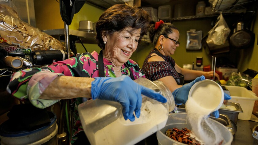 CITY OF INDUSTRY, CALIF. -- FRIDAY, MAY 4, 2018: Elena Castro help prepare food in the kitchen at Te