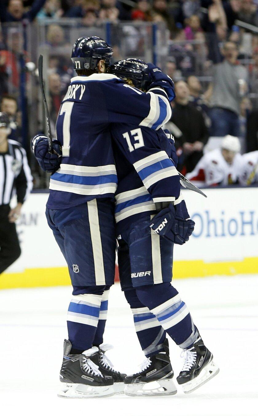 Columbus Blue Jackets' Brandon Dubinsky, left, and Cam Atkinson celebrate their goal against the Ottawa Senators during the second period of an NHL hockey game Saturday, Feb. 13, 2016, in Columbus, Ohio. (AP Photo/Jay LaPrete)