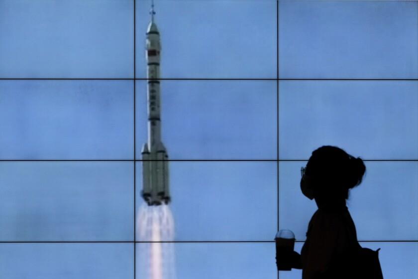 TV screen showing rocket launch