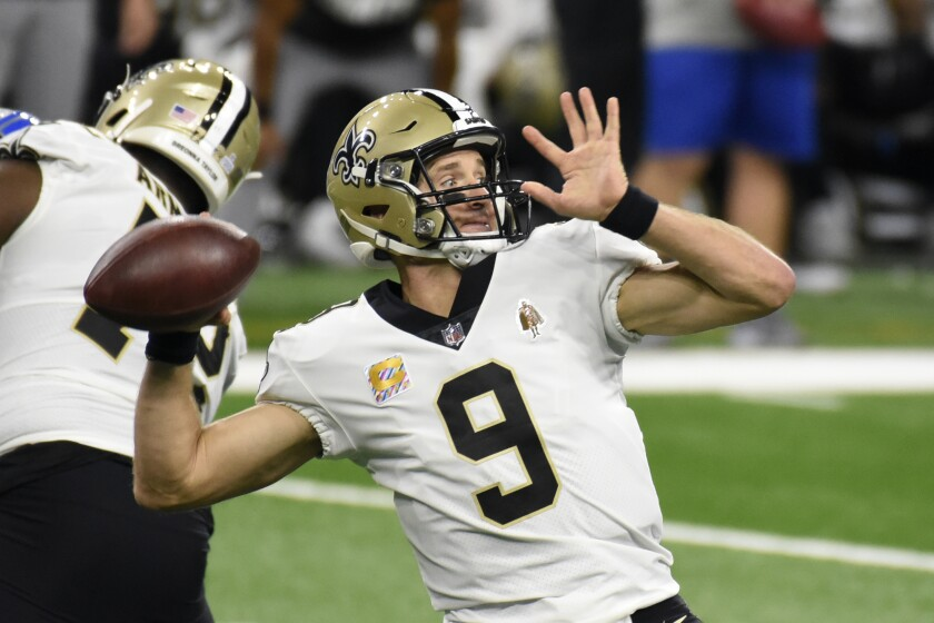 New Orleans Saints quarterback Drew Brees throws during the first half of an NFL football game against the Detroit Lions, Sunday, Oct. 4, 2020, in Detroit. (AP Photo/Jose Juarez)