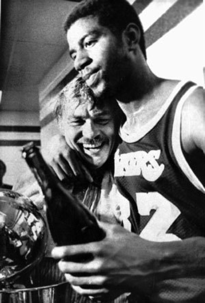 Magic Johnson and Jerry Buss celebrate the Lakers' title in 1980. It was their first NBA title as team owner and player.