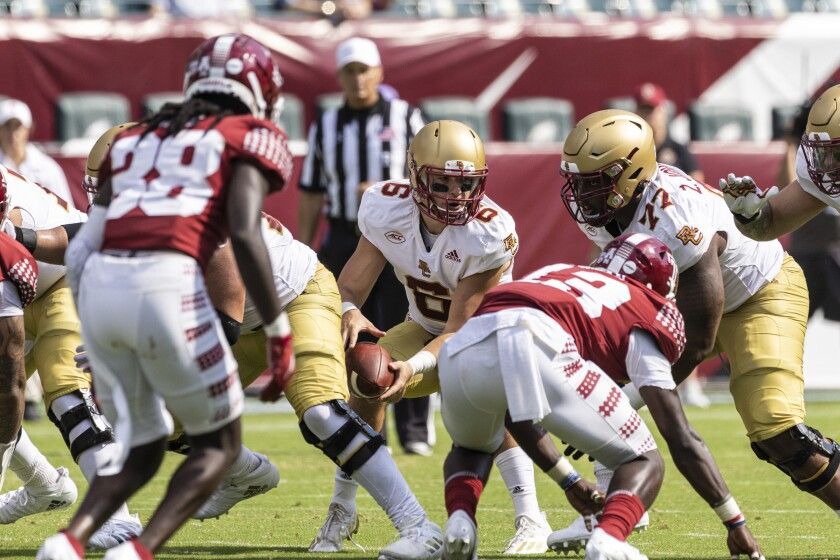 Boston College quarterback Dennis Grosel takes the snap against Temple during the second half of an NCAA college football game on Saturday, Sept. 18, 2021, in Philadelphia. (Tyger Williams/The Philadelphia Inquirer via AP)