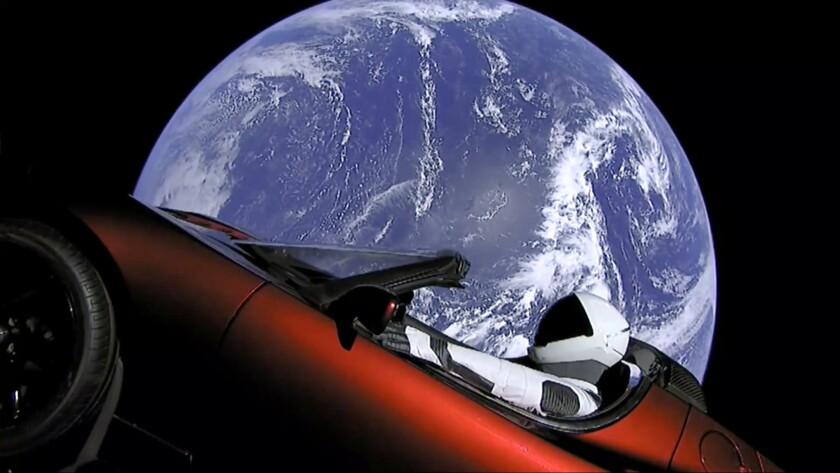 This image from video provided by SpaceX shows the company's spacesuit in Elon Musk's red Tesla spor