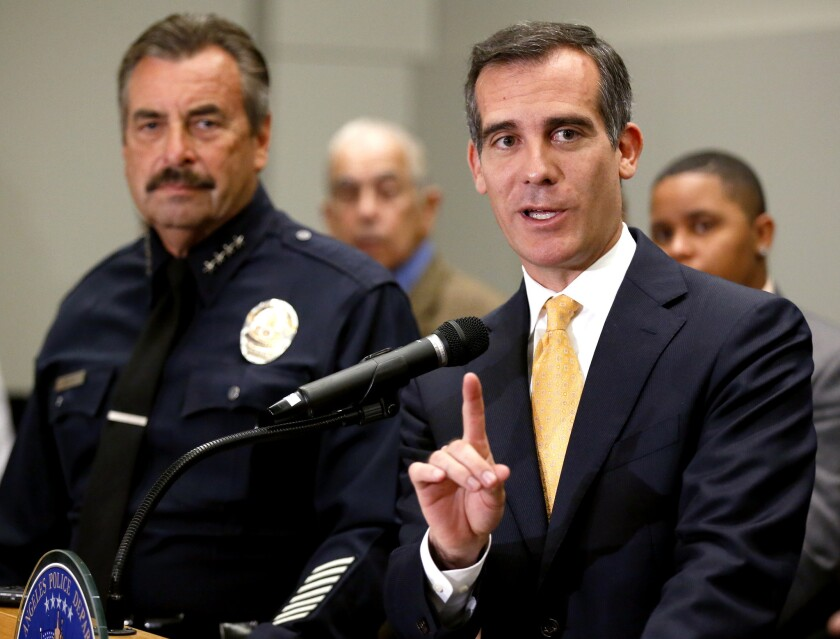 Los Angeles Mayor Eric Garcetti and LAPD Chief Charlie Beck discuss the mid year crime report at a July 8 press conference.