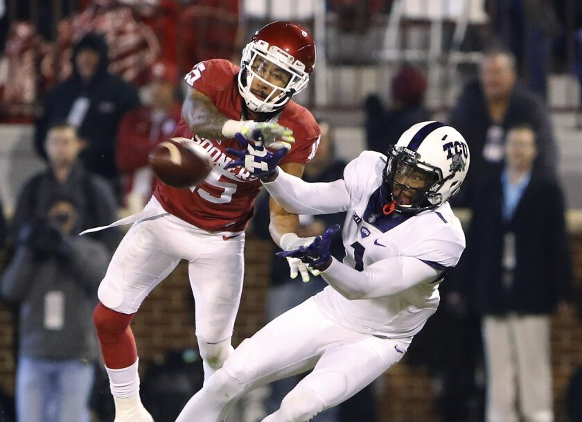 Oklahoma cornerback Zack Sanchez (15) breaks up a pass to TCU wide receiver Emanuel Porter (1) during the fourth quarter of an NCAA college football game in Norman, Okla., Saturday, Nov. 21, 2015. Oklahoma won 30-29. (AP Photo/Alonzo Adams)