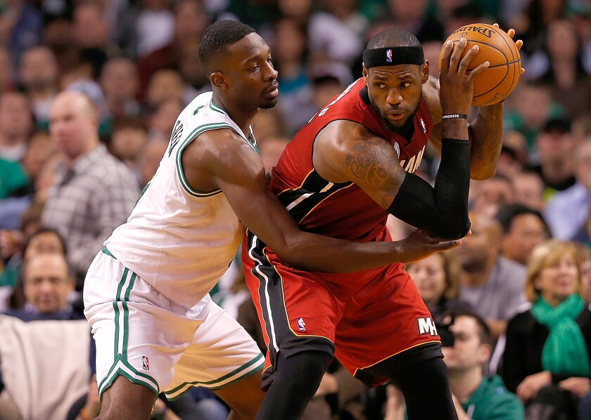 Boston Celtics forward Jeff Green defends Miami Heat forward LeBron James during the fourth quarter of a game on March 18, 2013 in Boston.