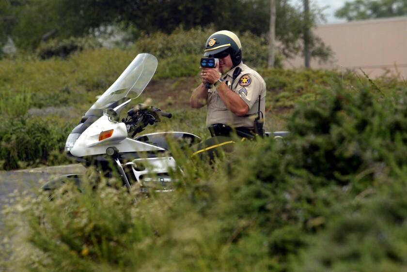 "A Ventura County Sheriff's deputy uses a ""laser-radar"" gun to catch speeders in Thousand Oaks."