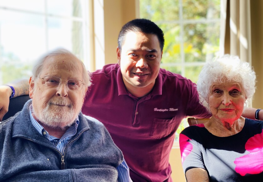 Residents George Bergstrom and Barb Winans with staff member Lyndon Derafera.
