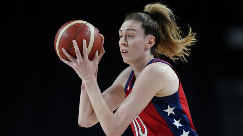 Breanna Stewart controls basketball during the victory over Australia at the Tokyo Olympics.
