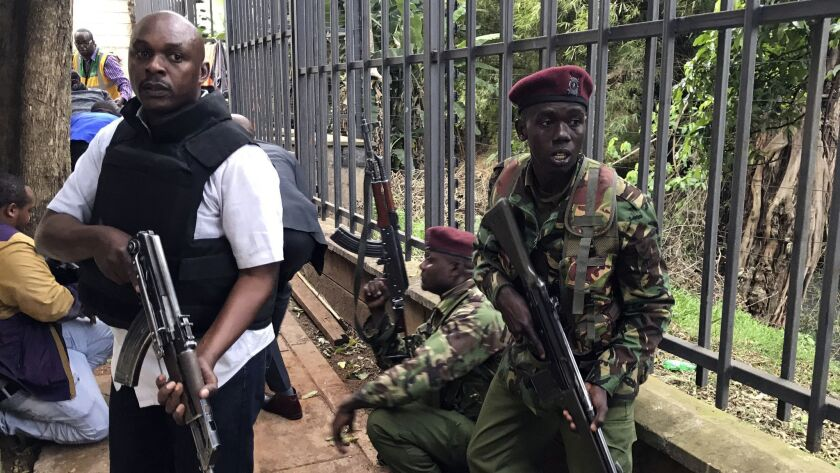 Security forces are seen at the scene of a blast in Nairobi, Tuesday, Jan. 15, 2019. An upscale hot
